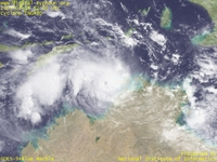 Typhoon Wallpaper Image : 2005 Cyclone INGRID : Cyclone INGRID reaching the Timor Sea with its eye still being visible (March 14, 2005, 0200 UTC)
